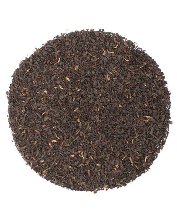 Assam loose leaf tea leaves in a cirlce.